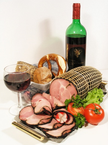 Wine and ham on a table
