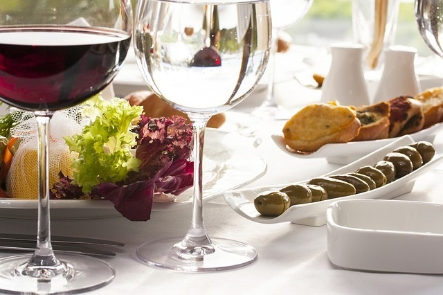 Glass of red wine on a table with food