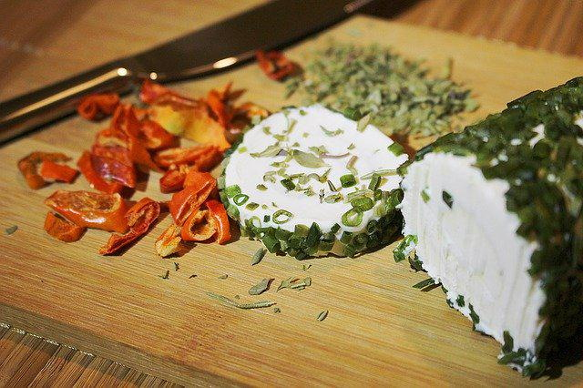 Herbed chevre goat cheese on a wood board