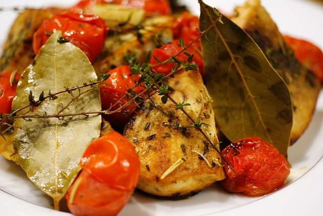 Swordfish with roasted tomatoes and bay leaves on a plate