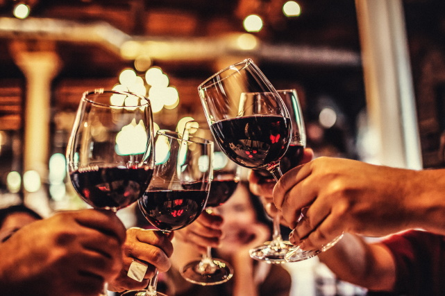 people-toasting-with-red-wine