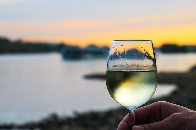 glass of white wine outdoors at sunset