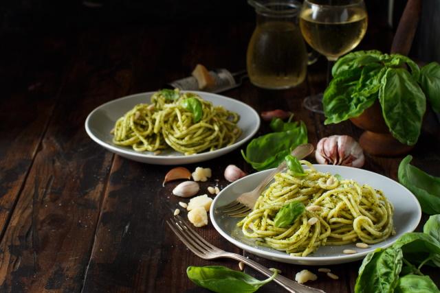 Spaghetti with pesto and glass of white wine
