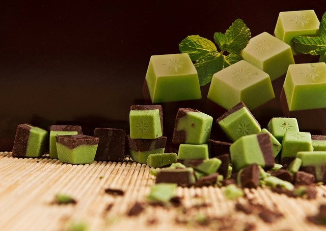 Pieces of green and brown chocolate in a pile