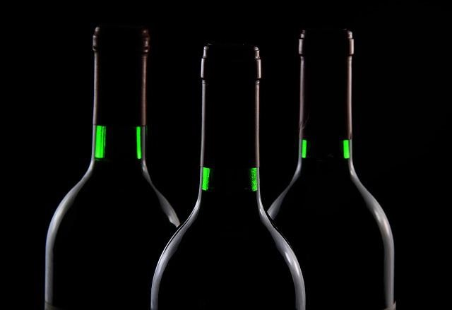 Wine bottles in the dark with no visible labels